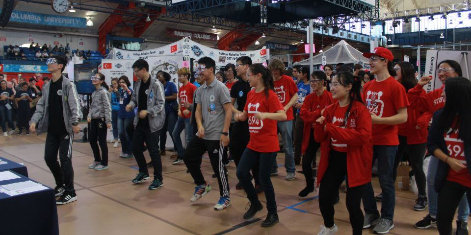 Team Members dancing with Team 6354 at the 2017 NYC Regional!